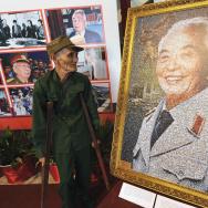 Xuan Hieu (L), 78, a Dien Bien Phu veter