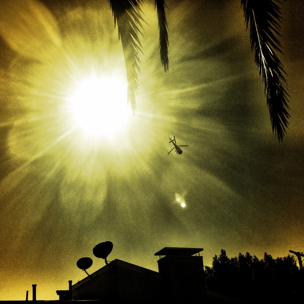 Three symbols of Southern California - the Sun, a police helicopter, and a palm tree - converge in Cypress Park.