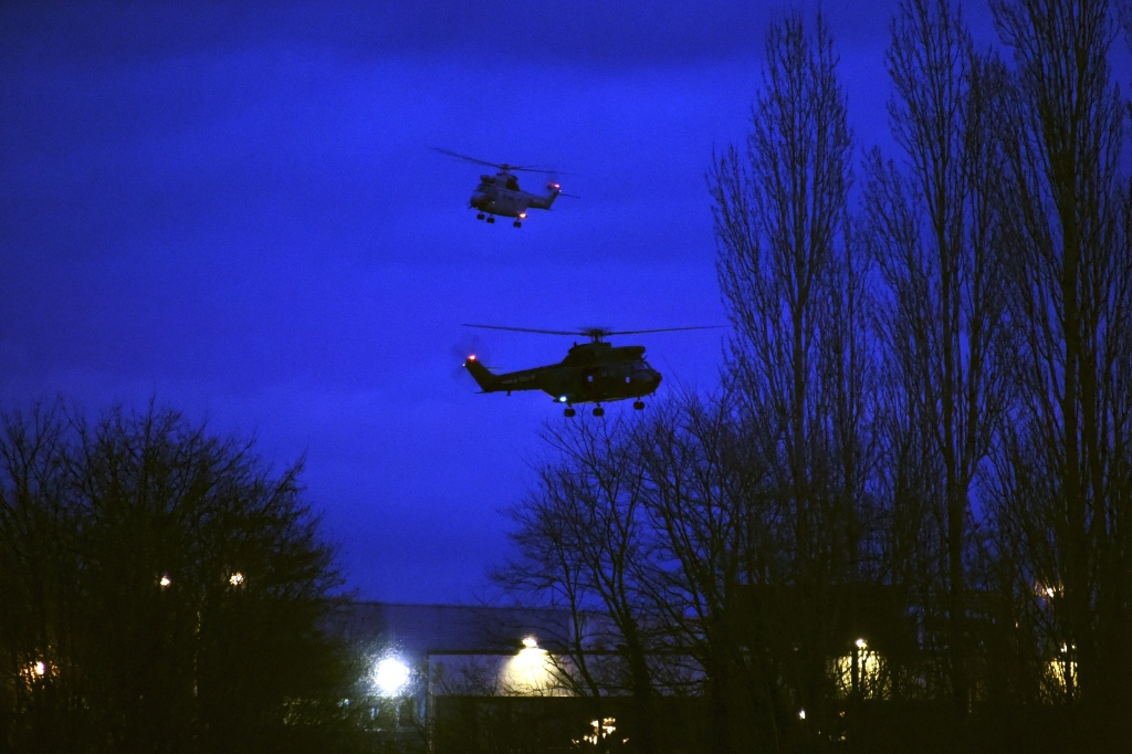 Helicopters fly over buildings in Dammartin-en-Goele, north-east of Paris, after two brothers suspected of slaughtering 12 people in an Islamist attack on French satirical newspaper Charlie Hebdo were shot dead by police, on Jan. 9, 2015.