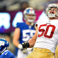 Chris Borland #50 of the San Francisco 49ers celebrates after a tackle against the New York Giants in the fourth quarter at MetLife Stadium on November 16, 2014 in East Rutherford, New Jersey.