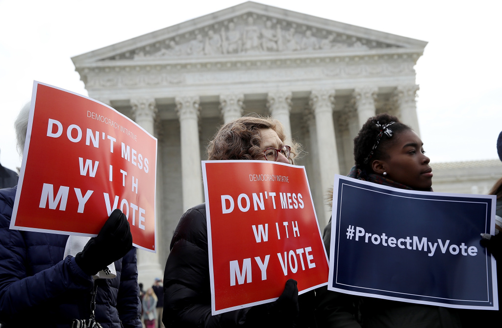 Protesters gather during a rally in front of the U.S. Supreme Court to oppose voter roll purges as the Supreme Court hears oral arguments in the Husted v. A Philip Randolph Institute, a challenge to Ohio's voter roll purges on January 10, 2018.