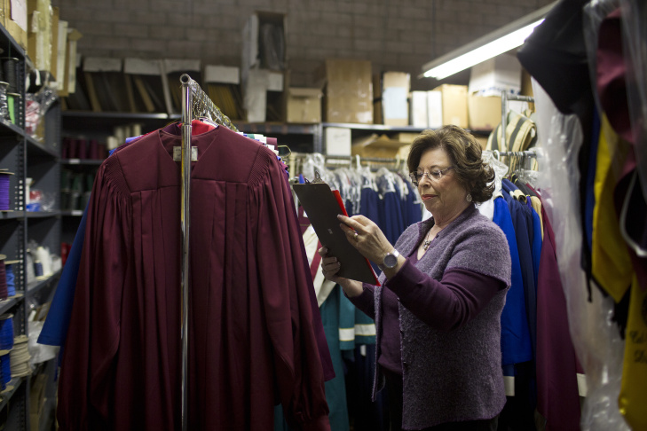 Vice President Evelyn Cronan checks samples before they're sent to customers at Academic Apparel, family-owned robe manufacturer in Chatsworth, on Thursday morning, Jan. 22. The company makes judicial robes, graduation gowns and other apparel.
