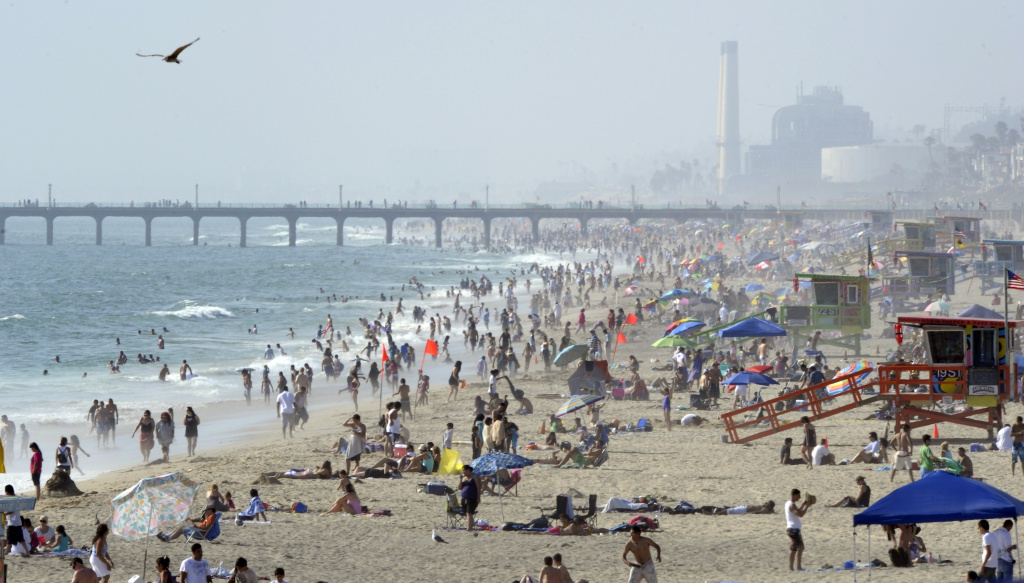 Crowds gather at the beach, Sunday, July 18, 2010, in Hermosa Beach, Calif.