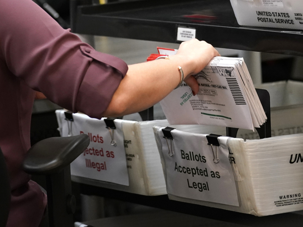 An election worker sorts vote-by-mail ballots at the Miami-Dade County Board of Elections in Doral, Fla., on Oct. 26, 2020. Florida's state legislature on Thursday approved a bill that would alter how residents can vote by mail.