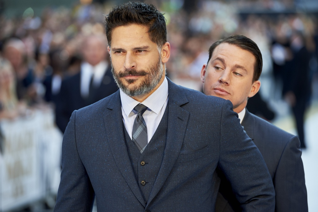 US actor Channing Tatum (R) plays a joke behind Joe Manganiello on arrival for the European premiere of Magic Mike XXL in central London on June 30, 2015.