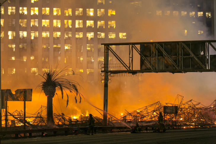 In this early Monday, Dec. 8, 2014, file photo, Los Angeles firefighters battle a fire at an apartment building under construction next to the Harbor Freeway (Interstate 110) in Downtown Los Angeles. The massive inferno gutted the 1.3 million-square-foot Da Vinci complex and damaged adjacent office towers. No one was hurt.
