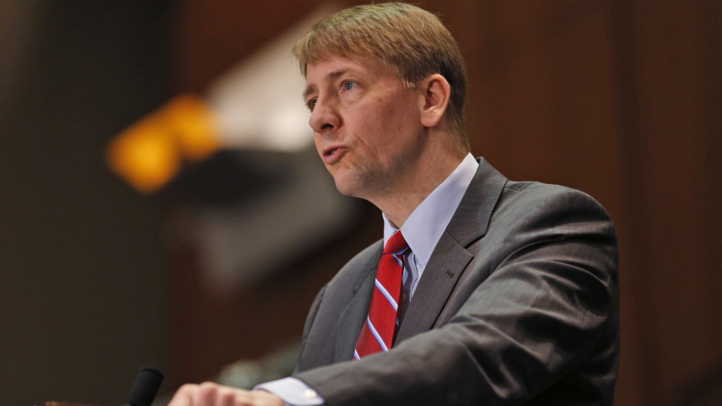 Consumer Financial Protection Bureau Director Richard Cordray says financial firms use arbitration to