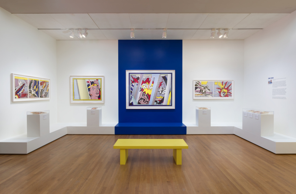 "Installation view of Pop for the People: Roy Lichtenstein in L.A.; ""Comic Books"" section featuring various works."