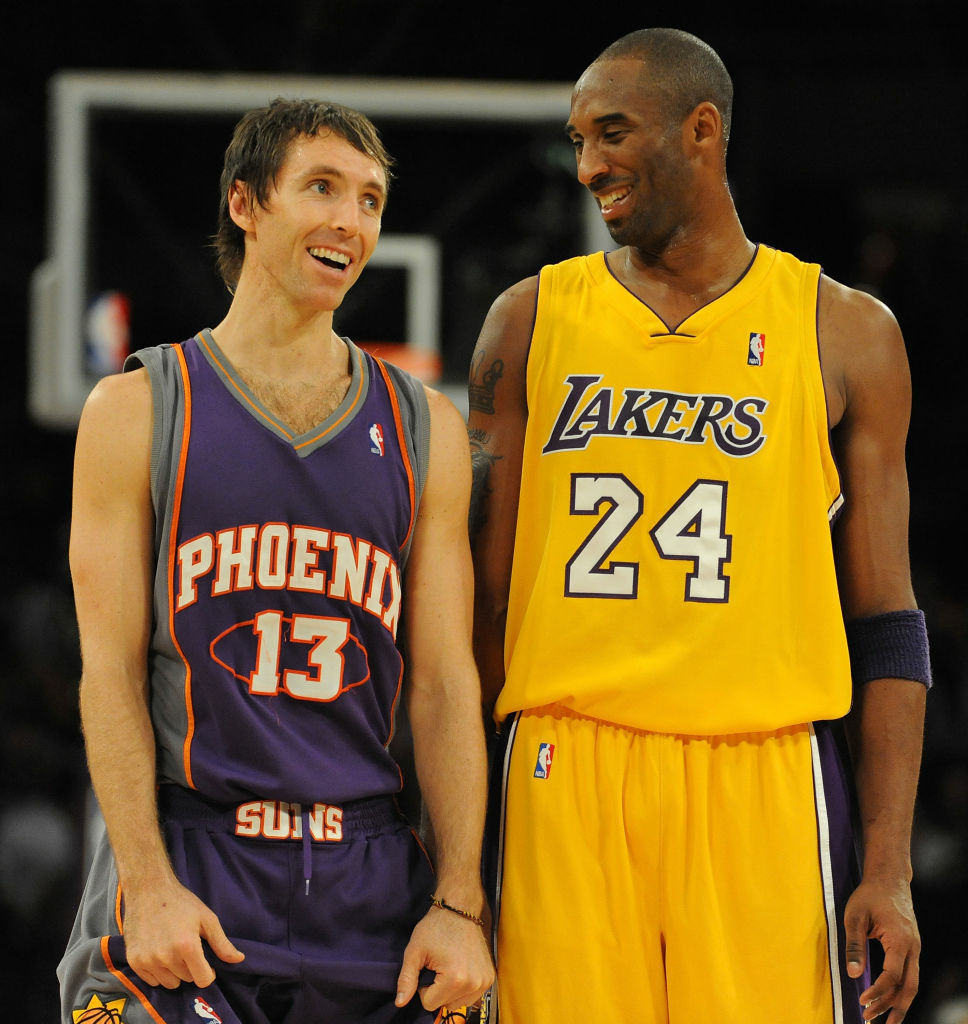 Steve Nash #13 of the Phoenix Suns laughs with Kobe Bryant #24 of the Los Angeles Lakers during the second half at the Staples Center in Los Angeles, California.