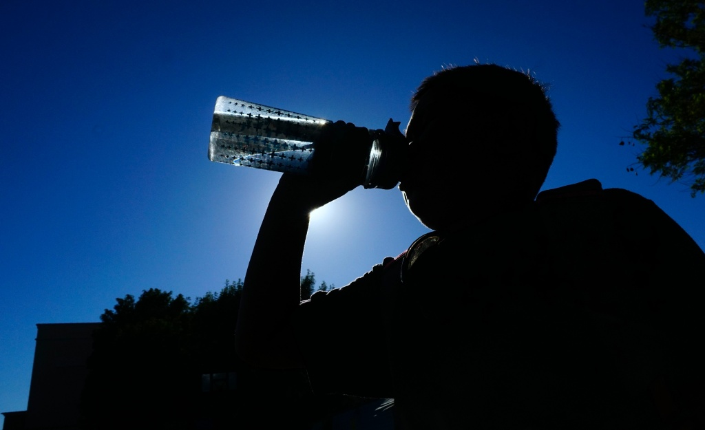 A child drinks from his water bottle amid an ongoing Southern California heatwave in Los Angeles, California on June 26, 2017, where several heat records were set a day earlier.