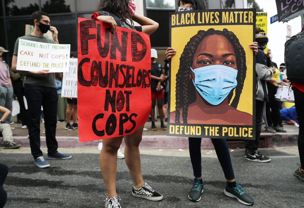 Black Lives Matter-Los Angeles supporters protest outside the Unified School District headquarters calling on the board of education to defund school police on June 23, 2020 in Los Angeles, California.