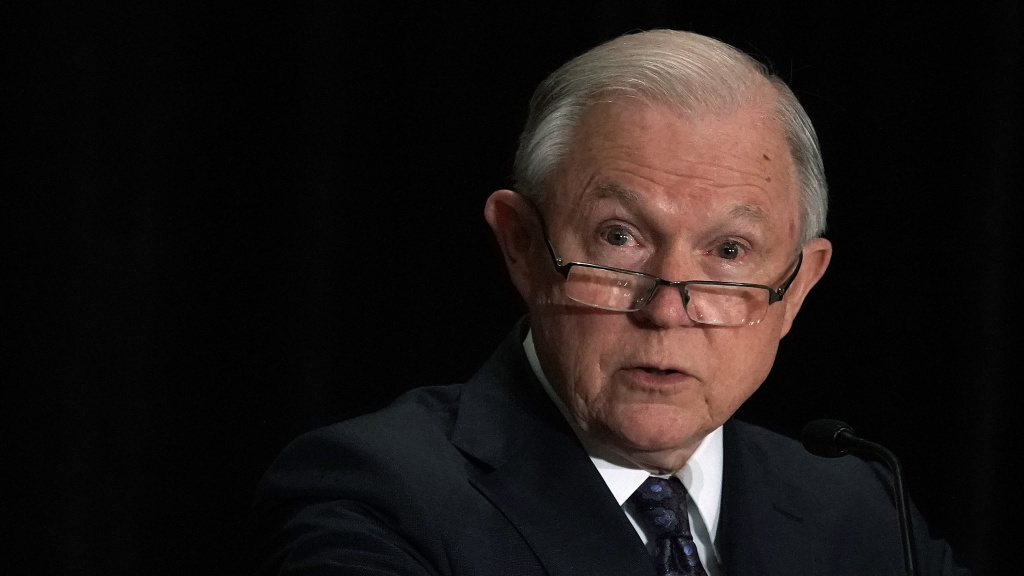 Attorney General Jeff Sessions delivers remarks at the Justice Department's Executive Officer for Immigration Review (EOIR) Annual Legal Training Program on Monday in Tysons, Va. Sessions spoke about his plan to limit reasons for people to claim asylum in the U.S.