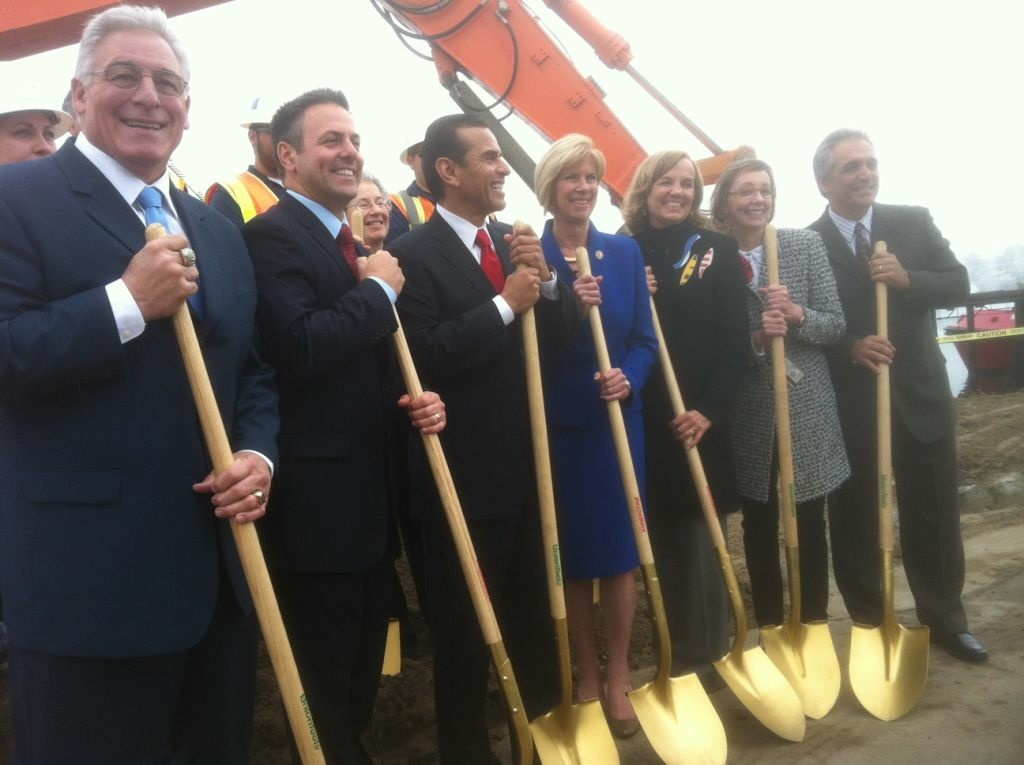 City leaders pose at the construction project's groundbreaking.