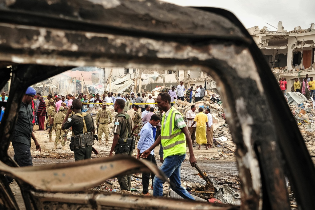 Somali soldiers patrol the scene where a truck bomb exploded in the center of Mogadishu on October 15, 2017.