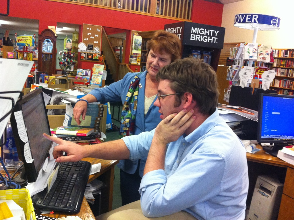 Bookstore owner Alzada Knickerbocker discusses an upcoming community event with manager Nicholas Weigand.