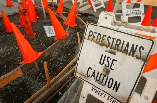 Cones cover the site of a public sidewalk repair project on February 10, 2009 in Los Angeles, California.