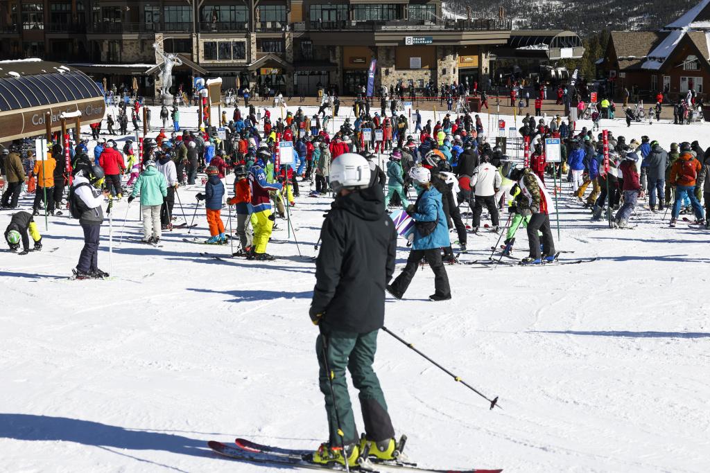 People wait in line for the ski lift on opening day at Breckenridge Ski Resort on November 13, 2020 in Breckenridge, Colorado.