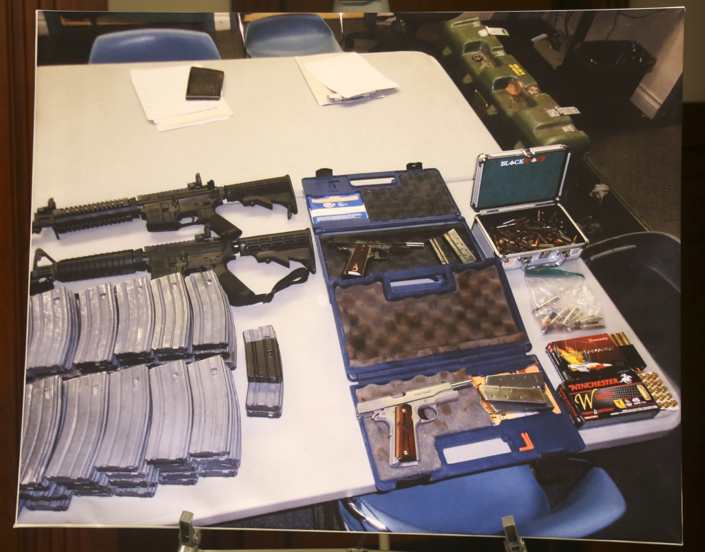 A confiscated cache of weapons is displayed at a news conference in Los Angeles on Wednesday, Feb. 21, 2018. Authorities say they've thwarted a student's plot for a mass shooting at a Southern California high school.