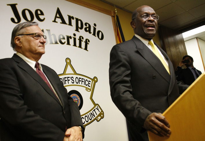 Herman Cain Holds Joint Press Briefing With Maricopa County Sheriff Joe Arpaio