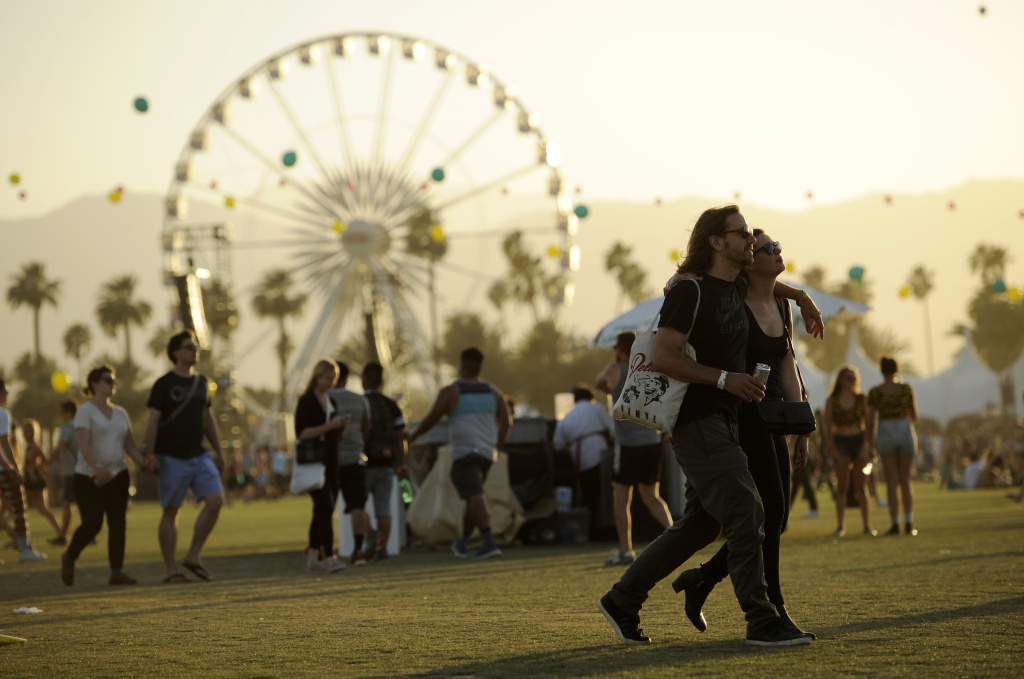 Coachella festivalgoers walk through the Empire Polo Field on the third day of the 2014 Coachella Music and Arts Festival on Sunday, April 13, 2014, in Indio, Calif. (Photo by Chris Pizzello/Invision/AP)