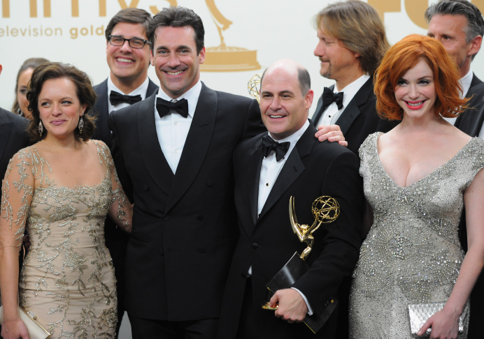 The cast and crew of 'Mad Men' including Elisabeth Moss, Jon Hamm, Matthew Weiner and Christina Hendricks pose in the press room during the 63rd Annual Primetime Emmy Awards held at Nokia Theatre L.A. LIVE on September 18, 2011 in Los Angeles, California on September 18, 2011 in Los Angeles, California.