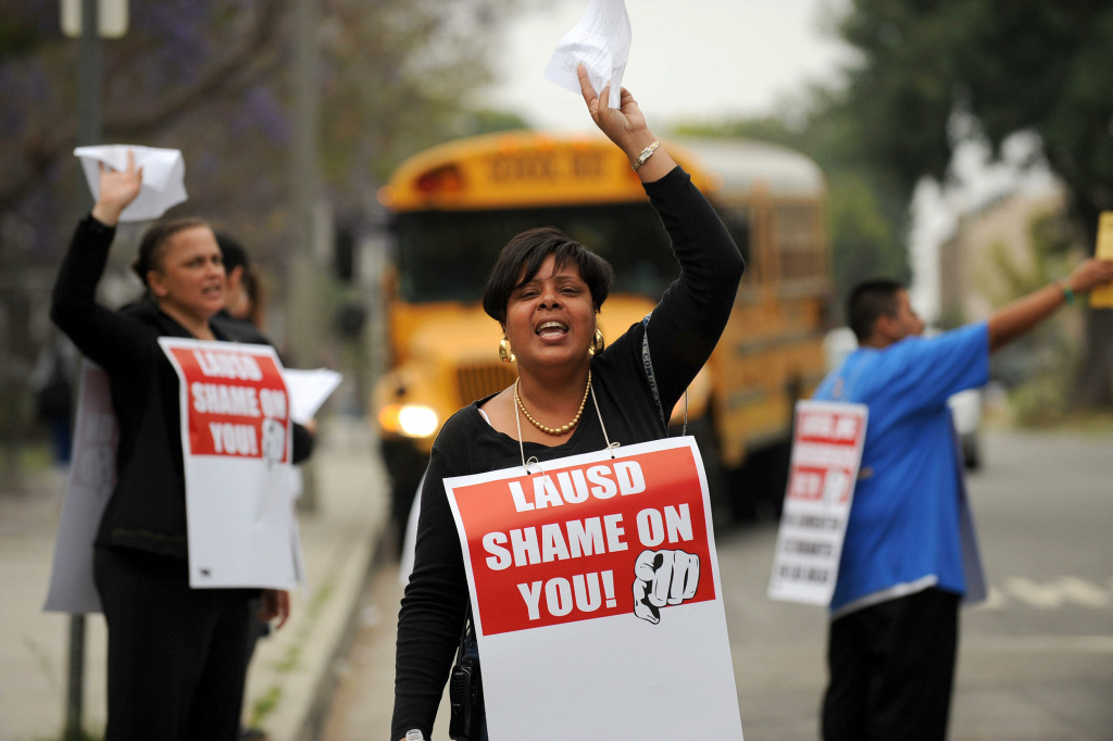 Teachers, parents, supporters and students picketed outside Crenshaw High School to protest  teacher layoffs in May, 2009.