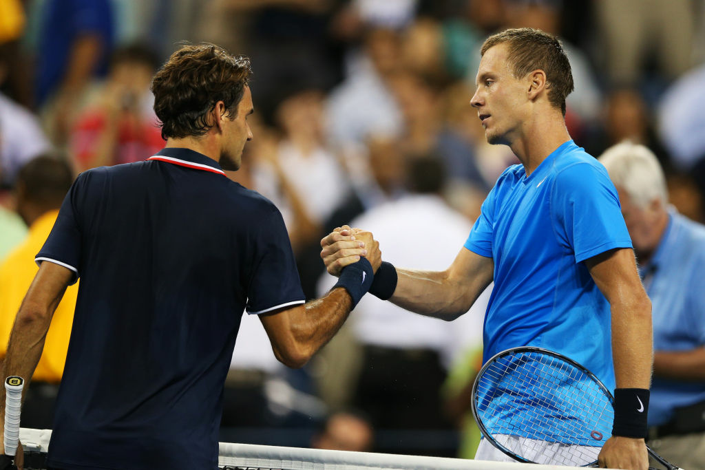 NEW YORK, NY - SEPTEMBER 05:  Tomas Berdych of the Czech Republic shakes hands with Roger Federer of Switzerland after their men's singles quarterfinal match against on Day Ten of the 2012 US Open at USTA Billie Jean King National Tennis Center on September 5, 2012 in the Flushing neighborhood of the Queens borough of New York City.  (Photo by Clive Brunskill/Getty Images)