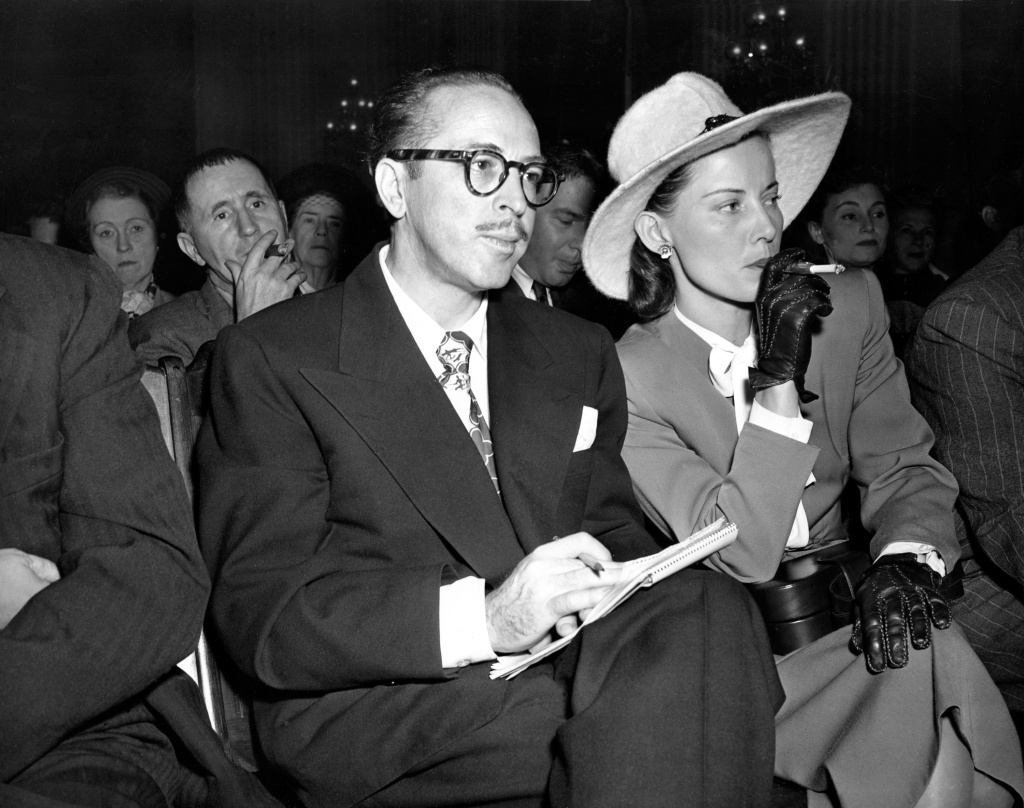 FILE - In this Oct. 28, 1947 file photo, screenwriter Dalton Trumbo, left, and his wife, Cleo, listen from the audience as the chairman of the House Un-American Activities Committee (HUAC) announces a contempt citation against Trumbo at a hearing in Washington, D.C.