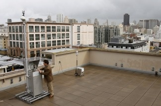 Eric Stevenson, director of technical services for the Bay Area Quality Management District, checks a radiation sensing device on March 23, 2011, in San Francisco.