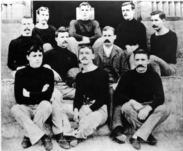 James Naismith, inventor of the game of basketball, with his first basketball team at the International YMCA Training School in Springfield, Massachusetts in 1891.