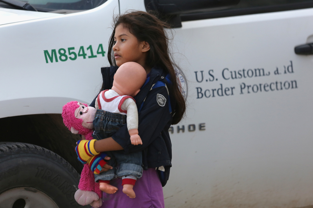 Salvadoran immigrant Stefany Marjorie, 8, holds her doll Rodrigo on July 24, 2014 in Mission, Texas. The White House has reportedly abandoned its search for additional shelter space for unaccompanied migrant minors, after the number of children and teens arriving at the U.S.-Mexico border has declined.