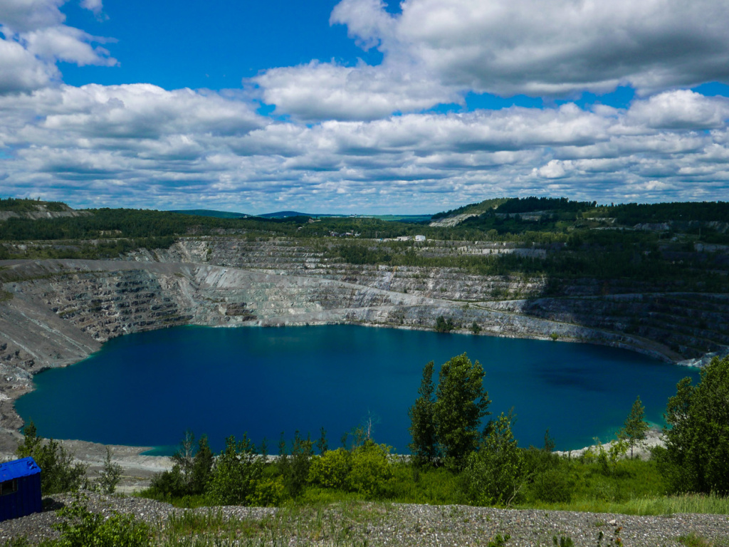 A photo taken in July shows what's left of the Jeffrey asbestos mine in Asbestos, Quebec. The town has voted to change its name to Val-des-Sources.