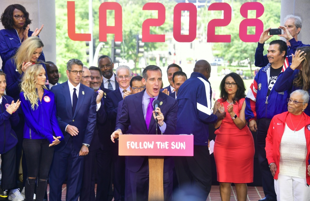 Los Angeles Mayor Eric Garcetti, joined by former Olympians speaks at a news conference on the steps of City Hall after the Los Angeles City Council's vote on the 2028 Olympics host city contract on August 11, 2017 in Los Angeles.