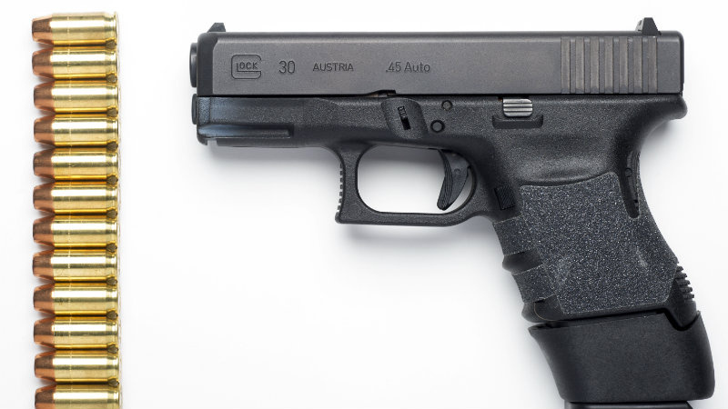 A Glock 30SF .45 Auto semi-automatic pistol with a Glock 13-round extension magazine installed, and 13 rounds of hollow-point ammunition are seen in Alexandria, Va., Wednesday, Feb. 10, 2016.