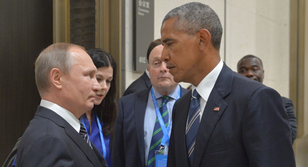 Russian President Vladimir Putin speaks with then-President Barack Obama in Hangzhou, China, on Sept. 5, 2016. Obama's warnings about active measures went unheeded.