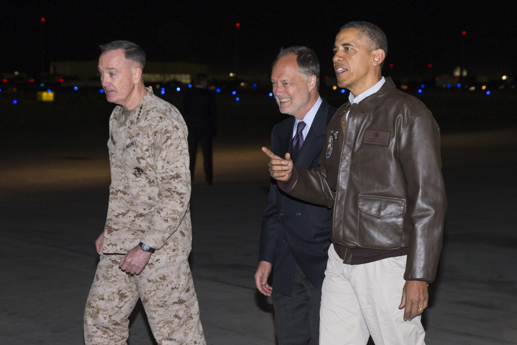 President Barack Obama, right, is greeted by U.S. Ambassador to Afghanistan James Cunningham, center, and Marine General Joseph Dunford, commander of the U.S.-led International Security Assistance Force (ISAF), as he arrives at Bagram Air Field for an unannounced visit, on Sunday.