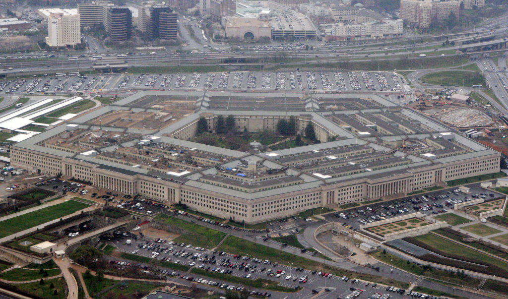 """FILE - The Pentagon is seen in this aerial view in Washington, in this March 27, 2008 file photo. President Donald Trump says he will bar transgender individuals from serving """"in any capacity"""" in the armed forces. Trump said on Twitter Wednesday, July 26, 2017, that after consulting with """"Generals and military experts,"""" that """"the U.S. Government will not accept or allow Transgender individuals to serve in any capacity in the U.S. Military."""" (AP Photo/Charles Dharapak, File)"""