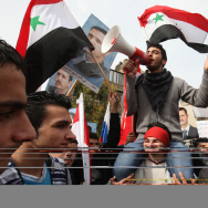 Syrians rally in front of the Russian Em