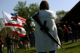 Gun rights groups gather at Fort Hunt Park for an 'Open Carry Rally' on April 19, 2010 in Alexandria, Va. The groups gathered in a National Park area to publicly carry weapons as a demonstration of their constitutional rights to bear arms.