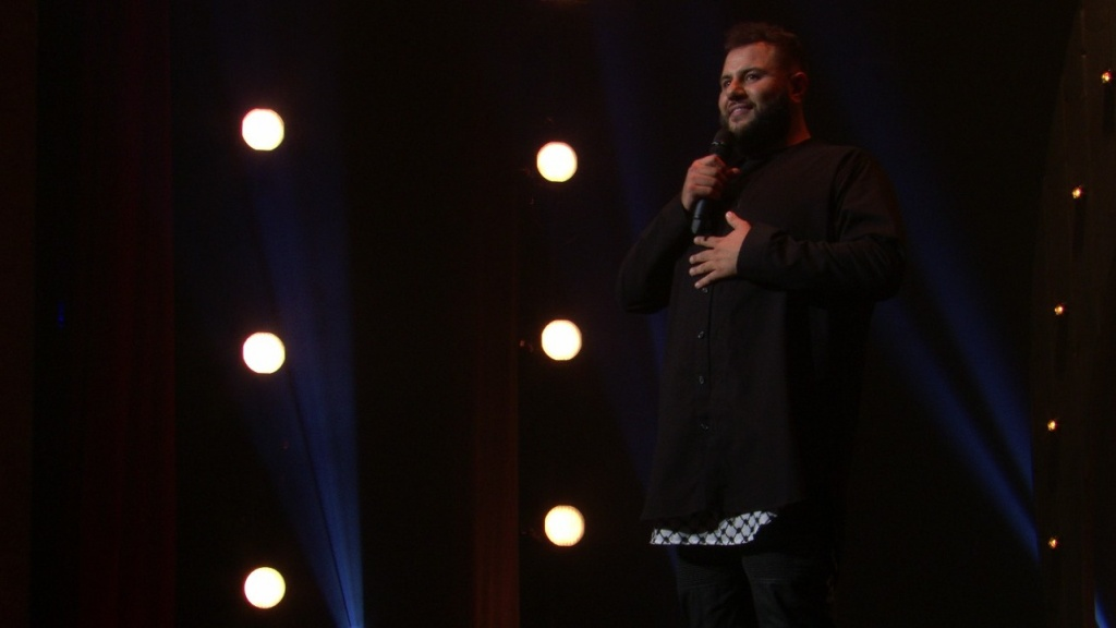 Comedian Mo Amer, seen here in his Netflix special <em>The Vagabond</em>, says that stand-up has been a significant part of his