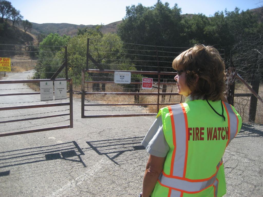 Joan Steiner keeps an eye out for anything suspicious on a recent Red Flag Warning day along Santiago Canyon Road.