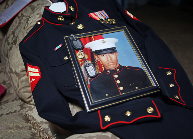 Itzcoatl Ocampo's dress uniform, government military photo, dog tags and a religious medallion that went to war with him lie on display at Ocampo's home in Yorba Linda, Calif., Sunday, Jan. 15, 2012. Ocampo, who spent time in Iraq, was named as a suspect in a series of killings of homeless men in Orange County, Calif. Family members declined to be photographed.