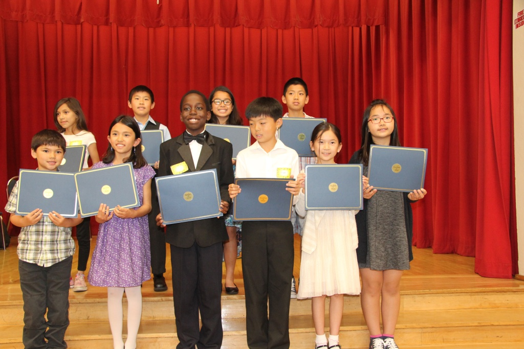Kevon Fortune, center, stands with other violin students who received scholarships for private lessons.