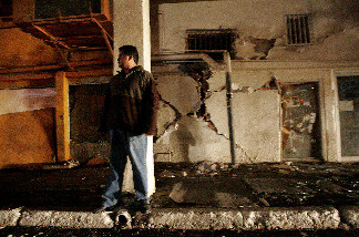 Alberto Montoya stands outside of his home after a 7.2 magnitude earthquake struck the area April 4, 2010 in Mexicali, Mexico.