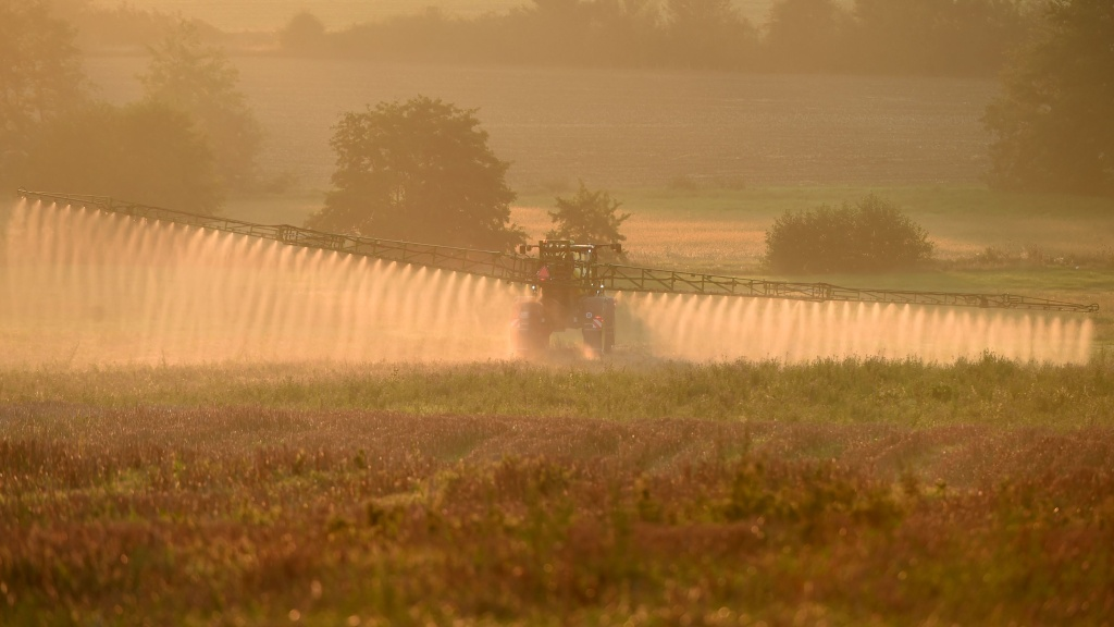 Bayer says a settlement worth more than $10 billion will resolve about 75% of the roughly 125,000 claims the company currently faces. Here, a French farmer sprays the glyphosate herbicide in Saint Germain-Sur-Sarthe, in northwestern France, last September.
