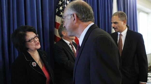 Elouise Cobell, a member of Montana's Blackfeet Tribe, and four other Native Americans led a class-action land use lawsuit against the U.S. government. Cobell is shown here in 2009 with Interior Secretary Ken Salazar after an announcement on the settlement of the lawsuit. Cobell died last year.