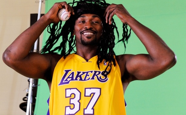"Ron Artest #37 of the Los Angeles Lakers - now legally named ""Metta World Peace"" wears a wig to resemble baseball player Manny Ramirez."