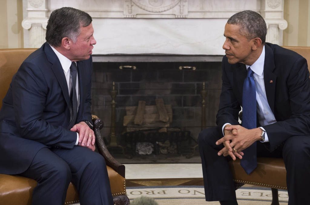 US President Barack Obama meets with King Abdullah II of Jordan in the Oval Office of the White House in Washington, DC, February 3, 2015. The hastily arranged meeting follows the release by the Islamic State of a video showing the apparent burning alive of a Jordanian pilot who had been captured late last year.LOEB/AFP/Getty Images)