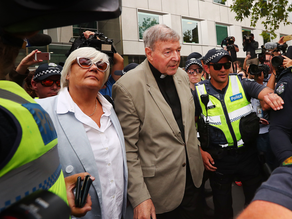 Cardinal George Pell leaves the court in Melbourne, Australia. Pell was convicted on five counts of child sexual assault in December 2018 but that verdict has just been released in Australia.