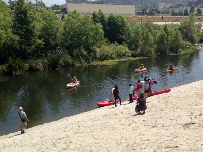 Kayakers on the L.A. River near Marsh Park during the opening day of the new